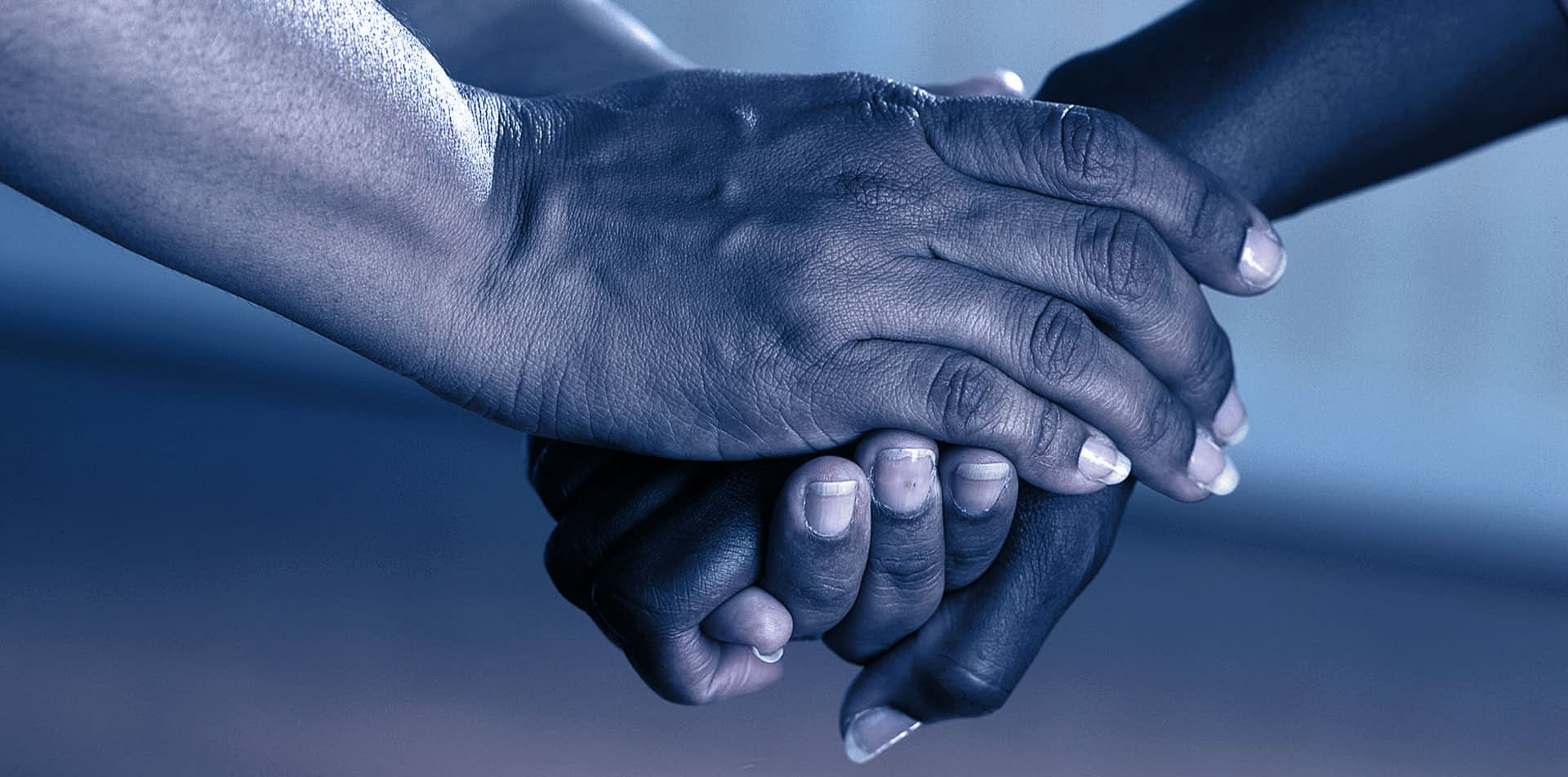 Two people shaking hands in partnership