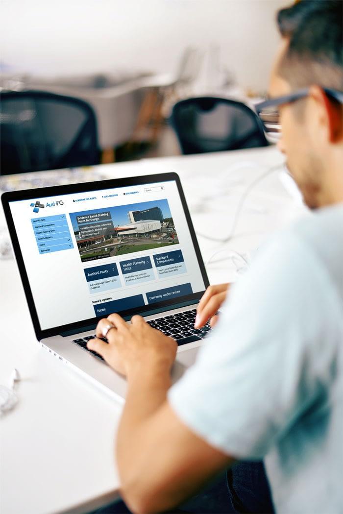Man using AusHFG website on a laptop